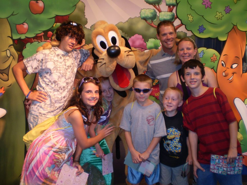 Family of eight with Pluto in EPCOT