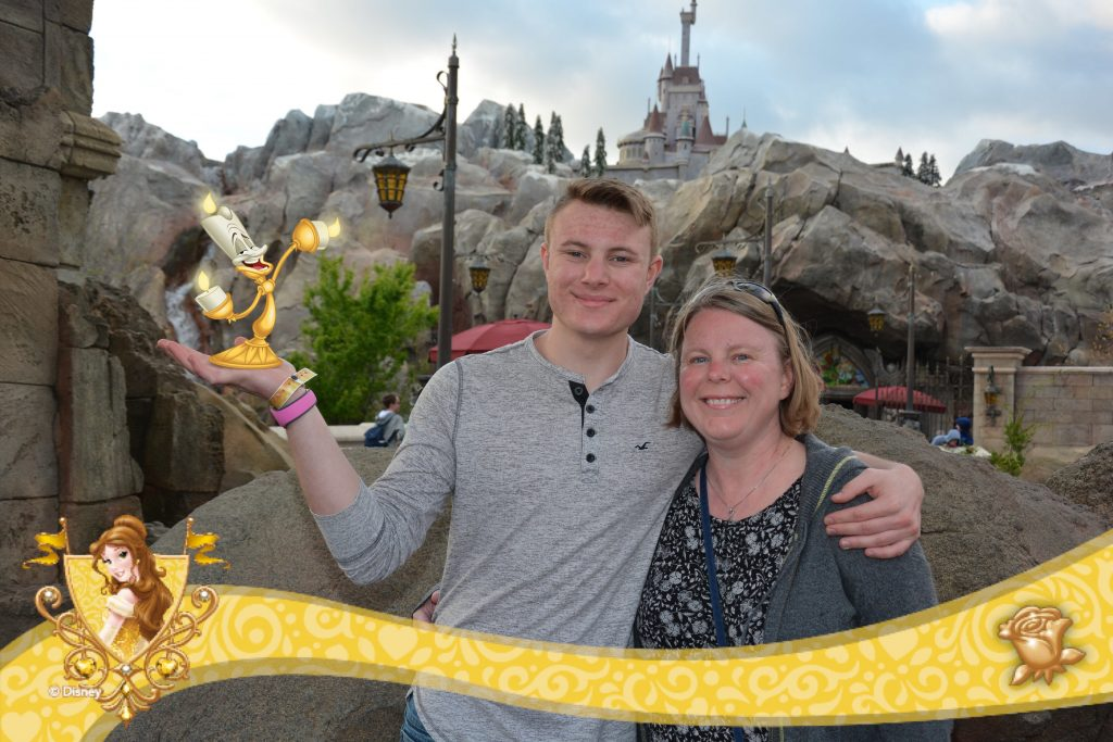 Mom and son at Disney World outside of the Beast's Castle