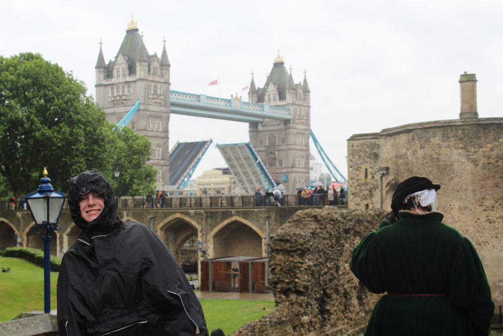 Teen Girl in rain poncho in front of the London Bridge