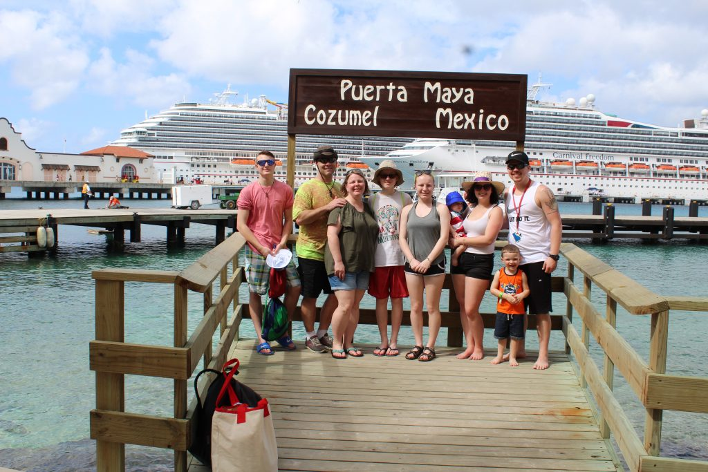 Three generations of family in front of cruise ships in Cozumel Mexico