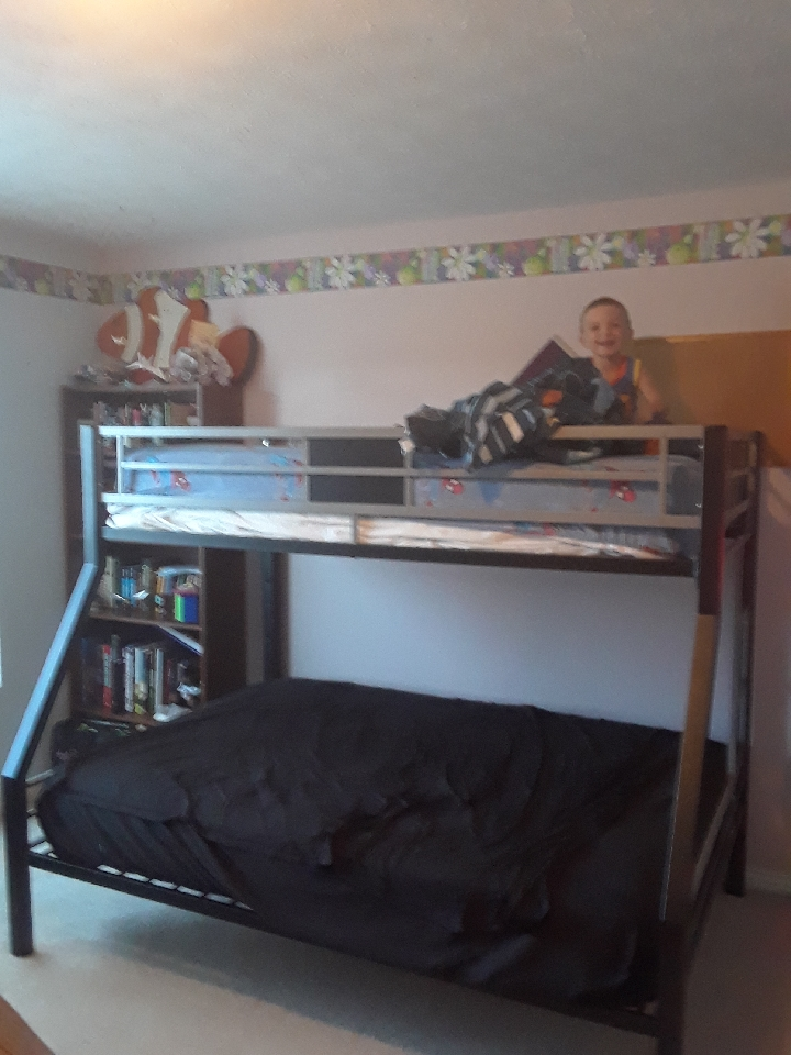 preschool child on top of bunk bed