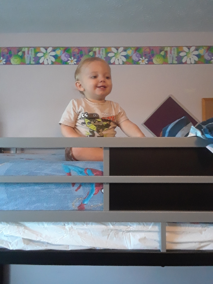 baby on top of bunk bed