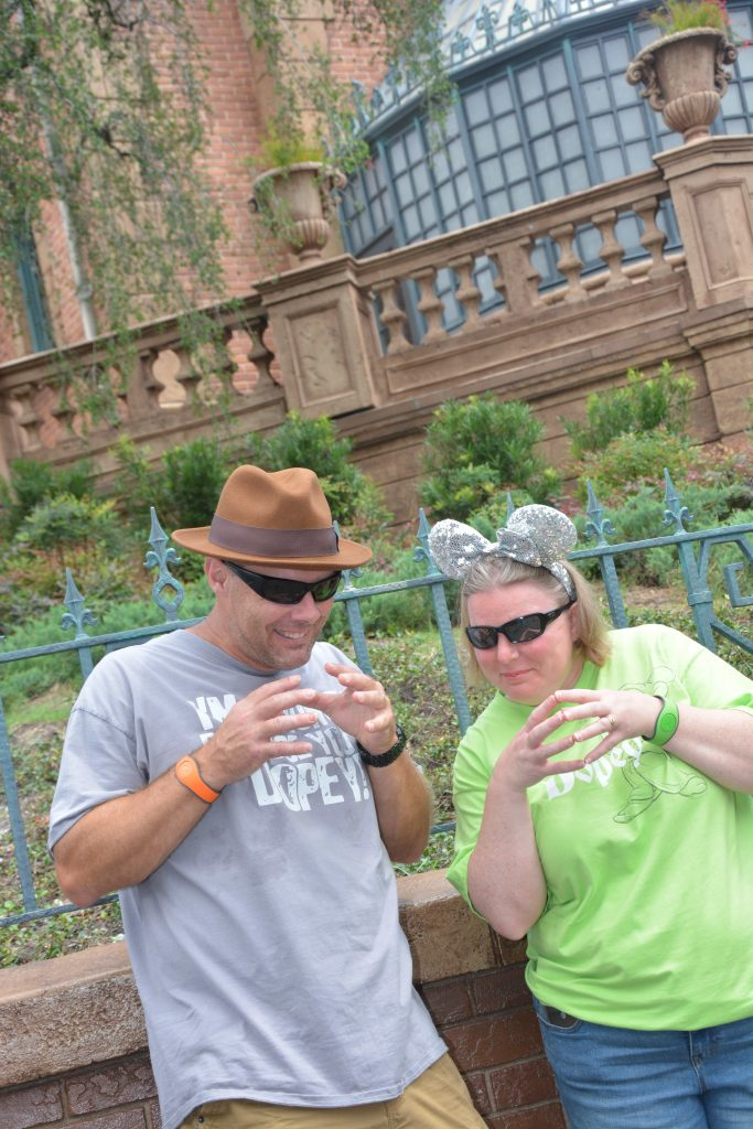 Husband and wife outside of the Haunted Mansion in Magic Kingdom at Walt Disney World