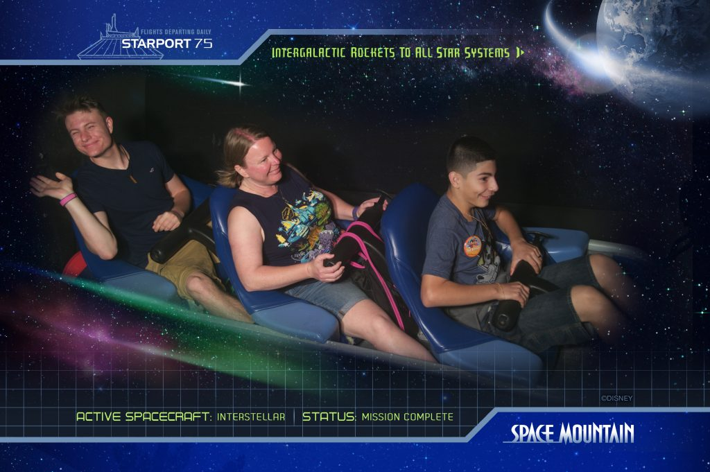 Three people on Space Mountain in Disney's Magic Kingdom