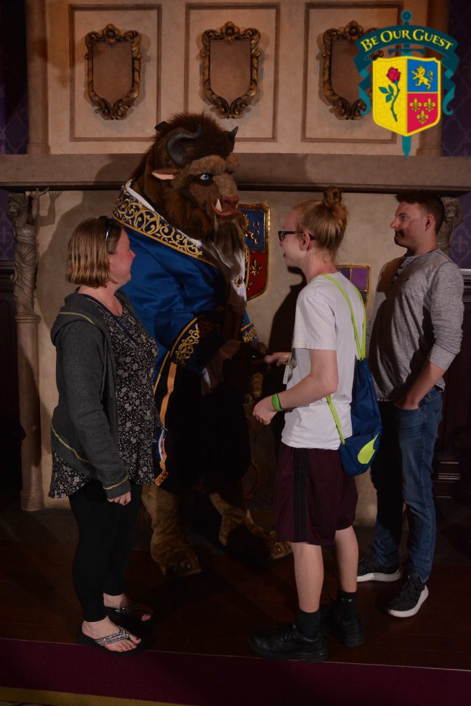 Two teen boys with the Beast in Disney's Magic Kingdom