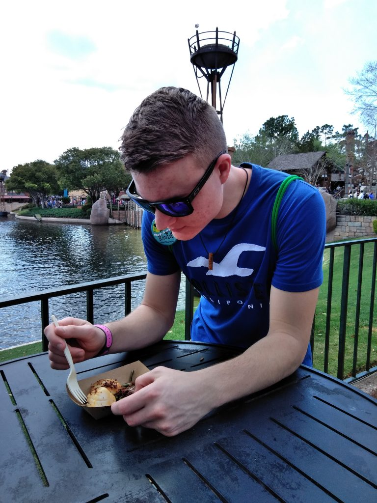 Teen boy eating in EPCOT