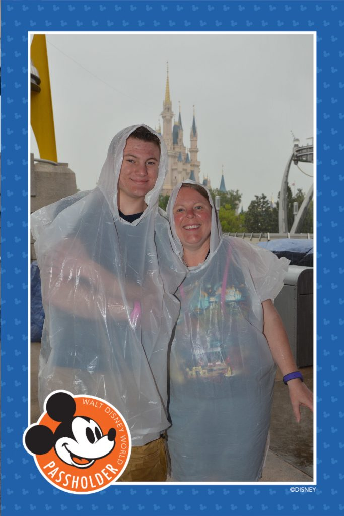 Mom and son in rain ponchos at Magic Kingdom
