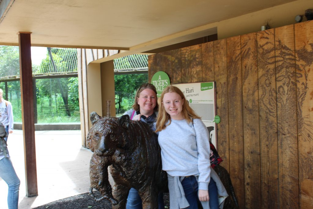 Mom and daughter with statue at London Zoo