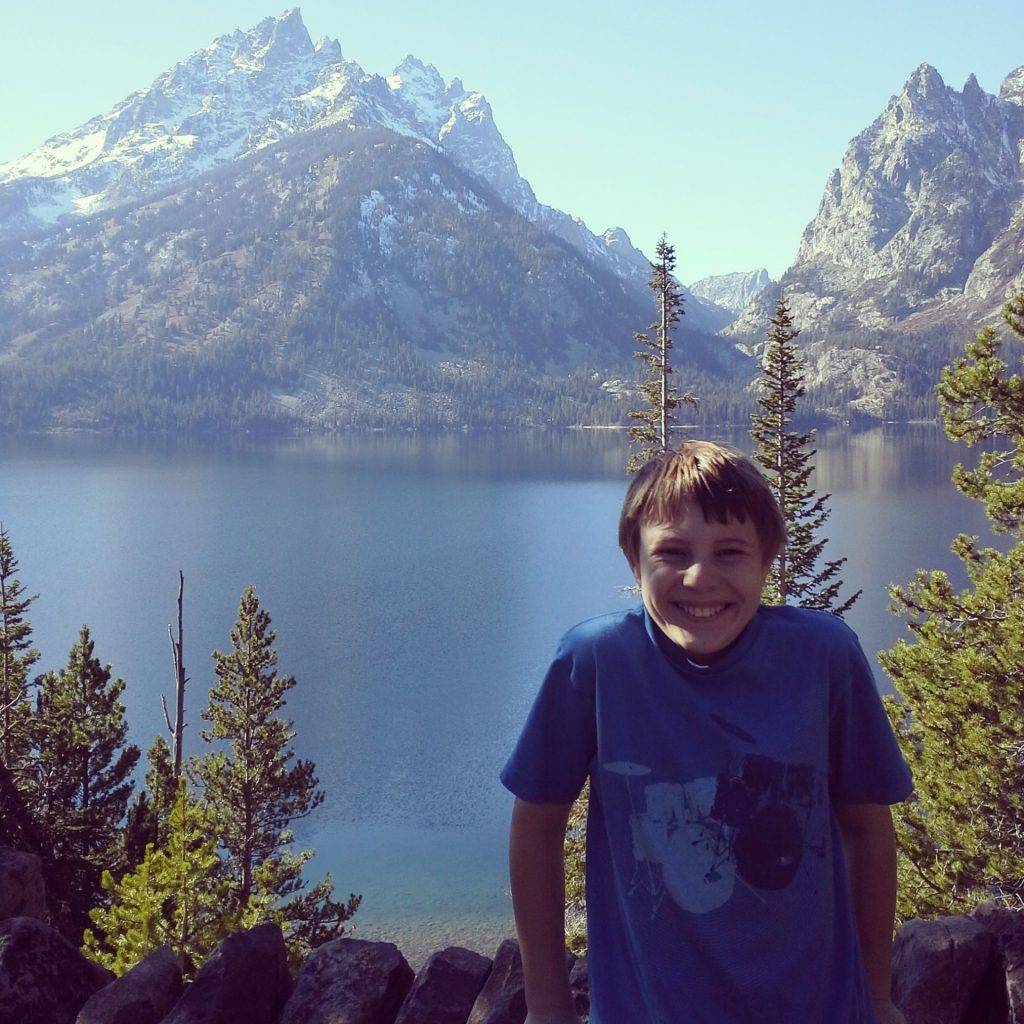 Boy with moutain range behind him