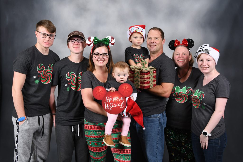 Christmas family photo at Disney Springs