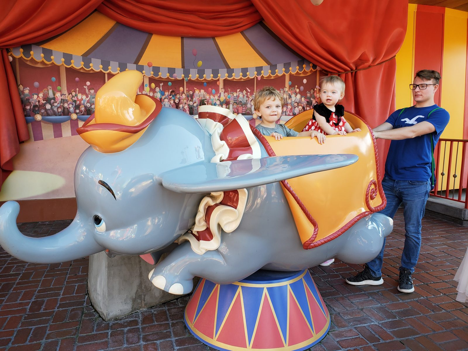 Kids at Magic Kingdom at Dumbo ride
